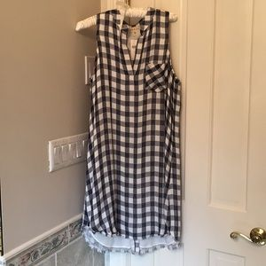 Lined sleeveless dress; buttons down the back.